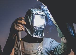 man wearing automatic dark welding helmet