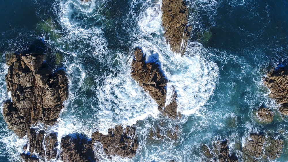 ocean waves hammering stone formation