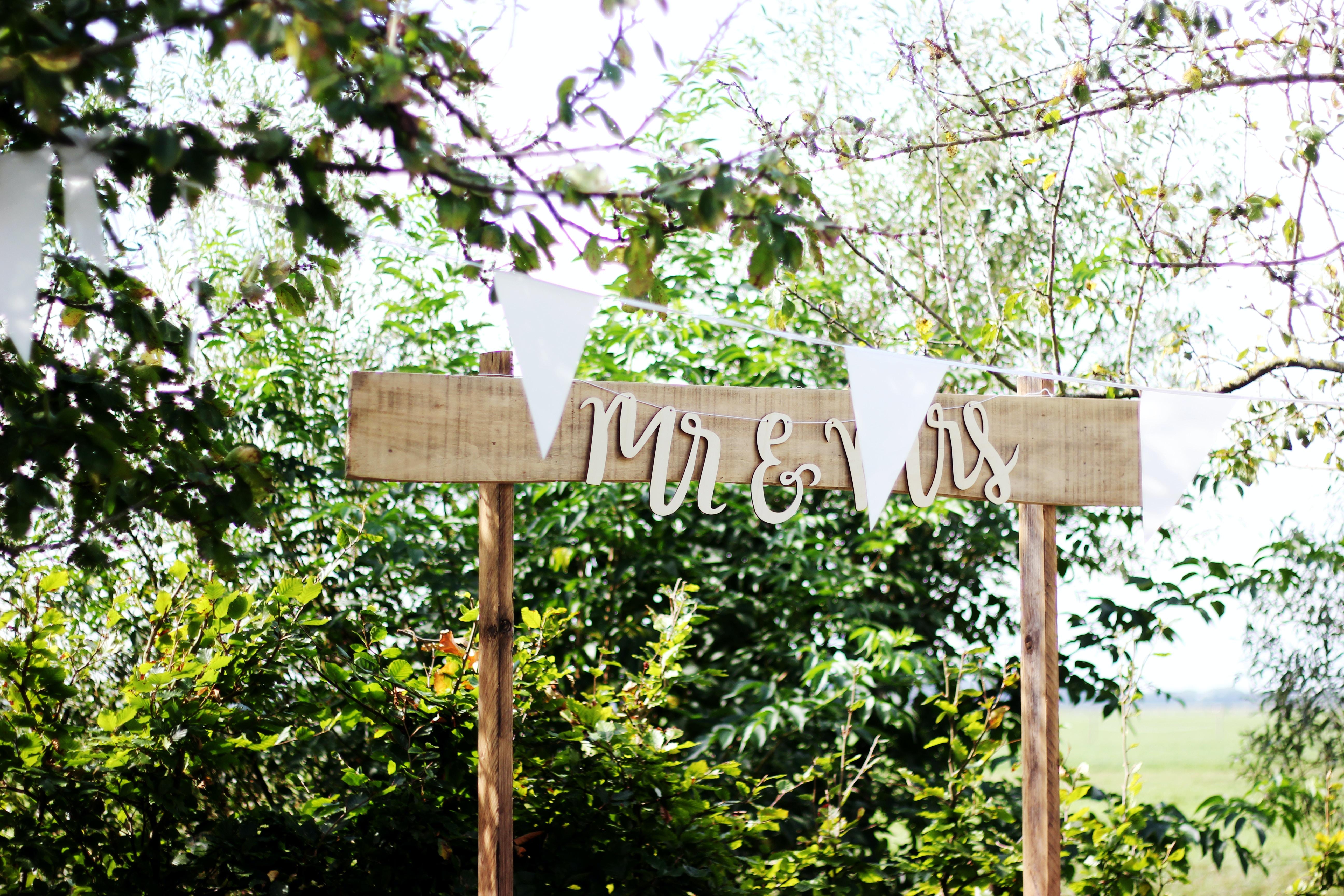 beige Mr & Mrs wooden sign during daytime