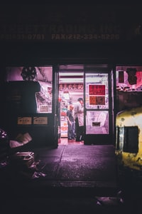 two man standing inside store during nighttime