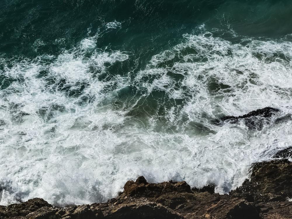 sea waves crashing on rock