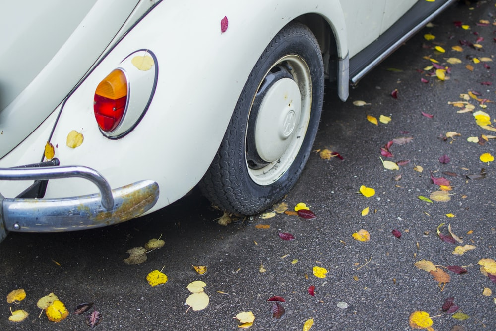 white Volkswagen Beetle on road