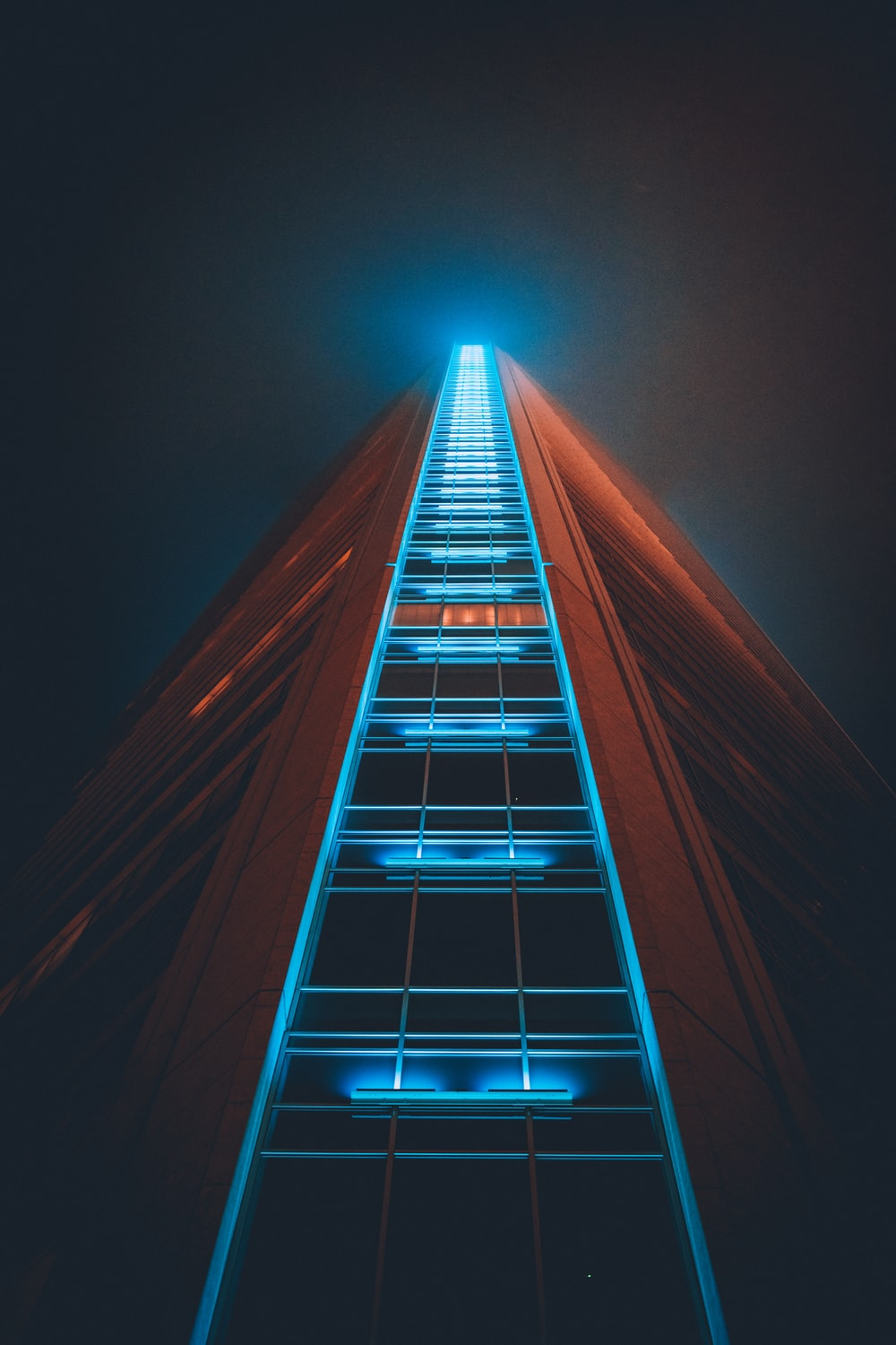 low angle photography of lighted high rise building
