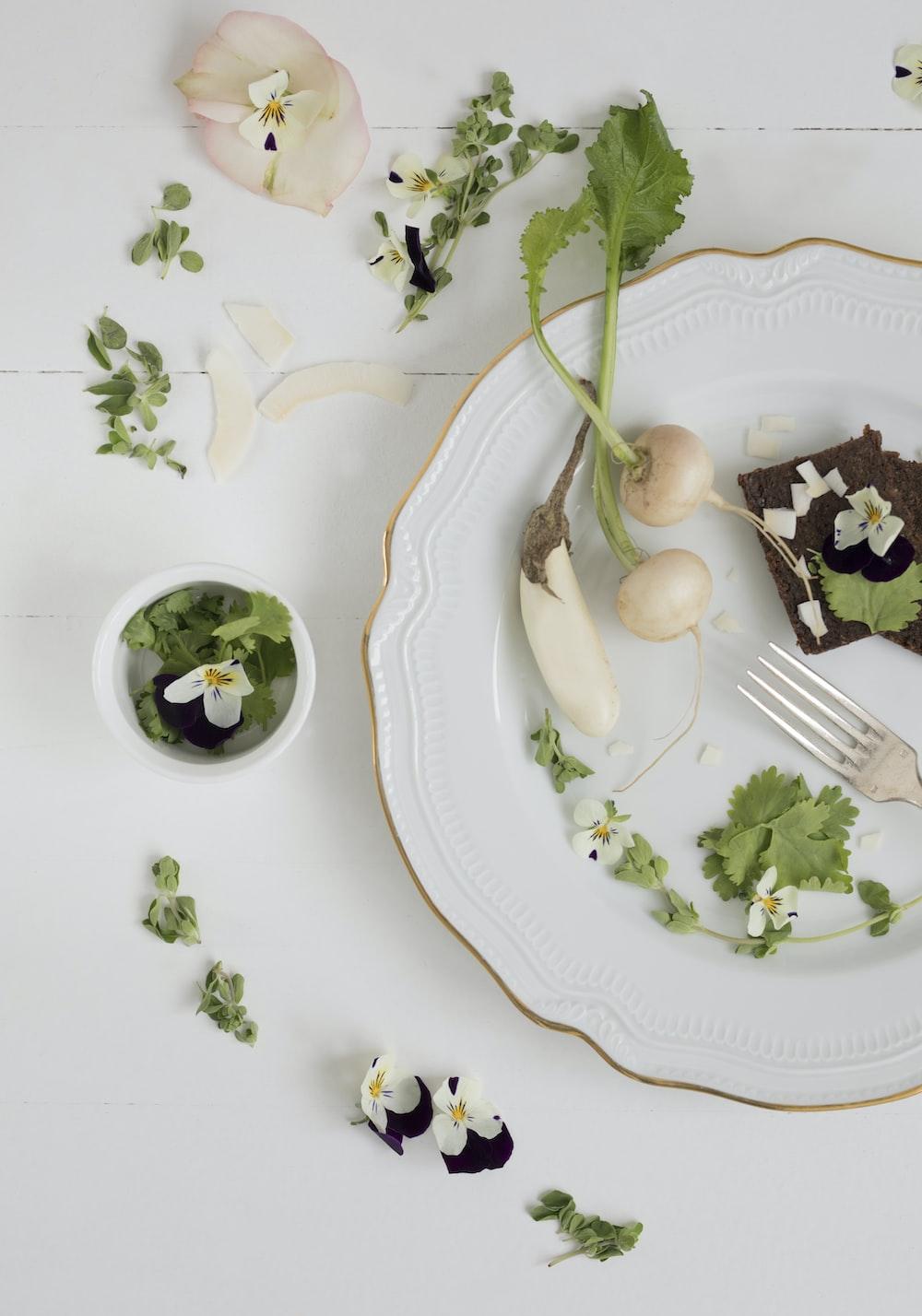 sliced vegetable on white plate