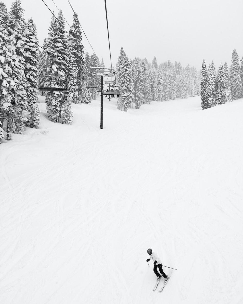 man doing ski near cable car
