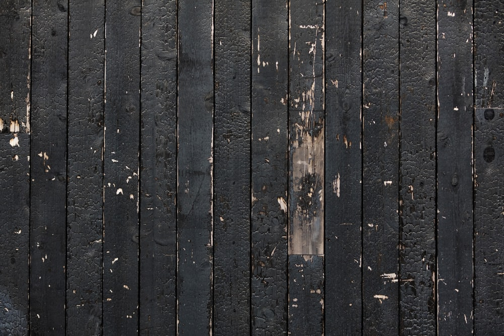 close up photo of black wooden board