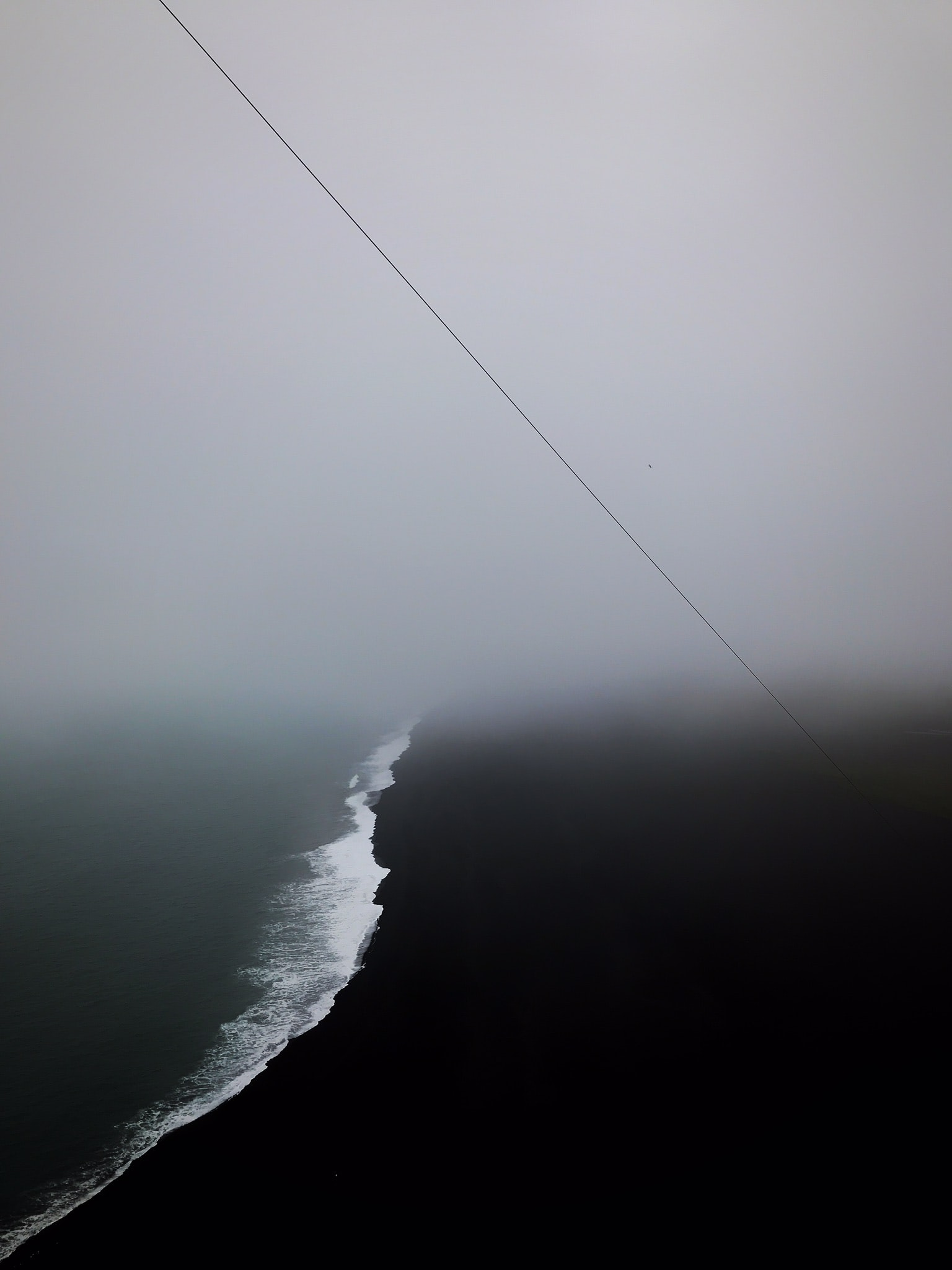 aerial view photography of body of water surrounded by fogs