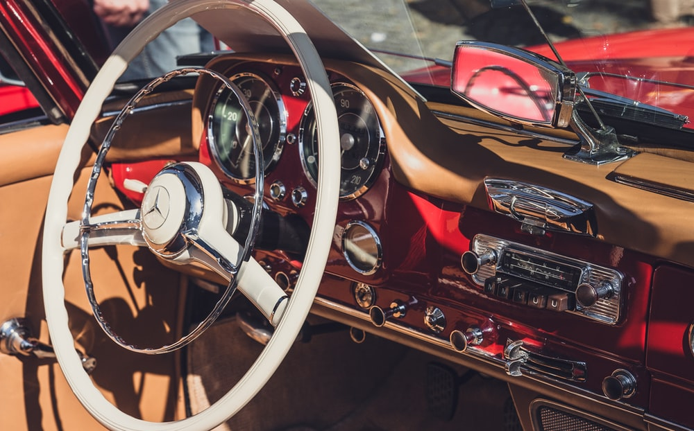 closeup photography of white Mercedes-Benz vehicle steering wheel