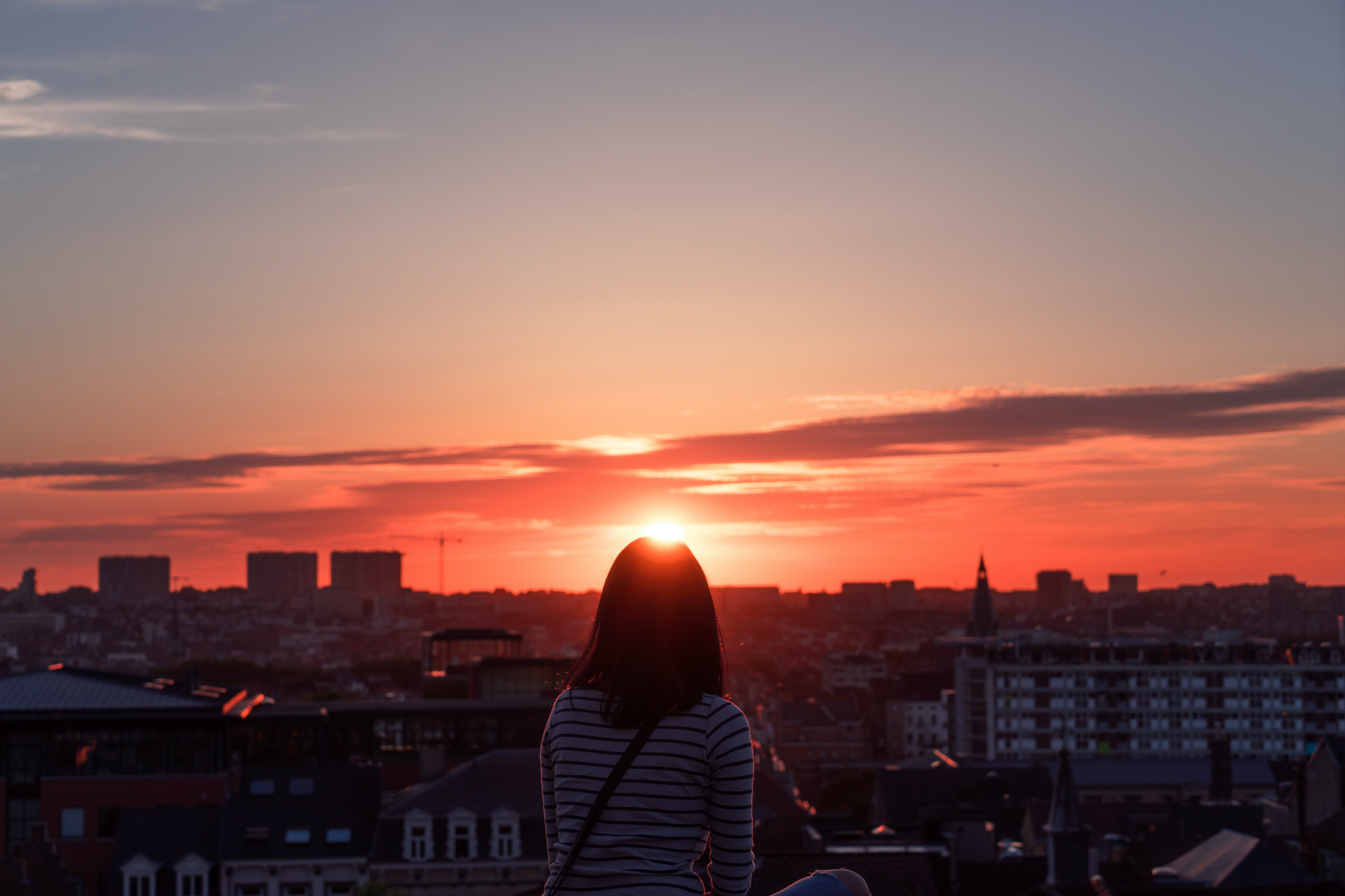 woman standing in front of sunset