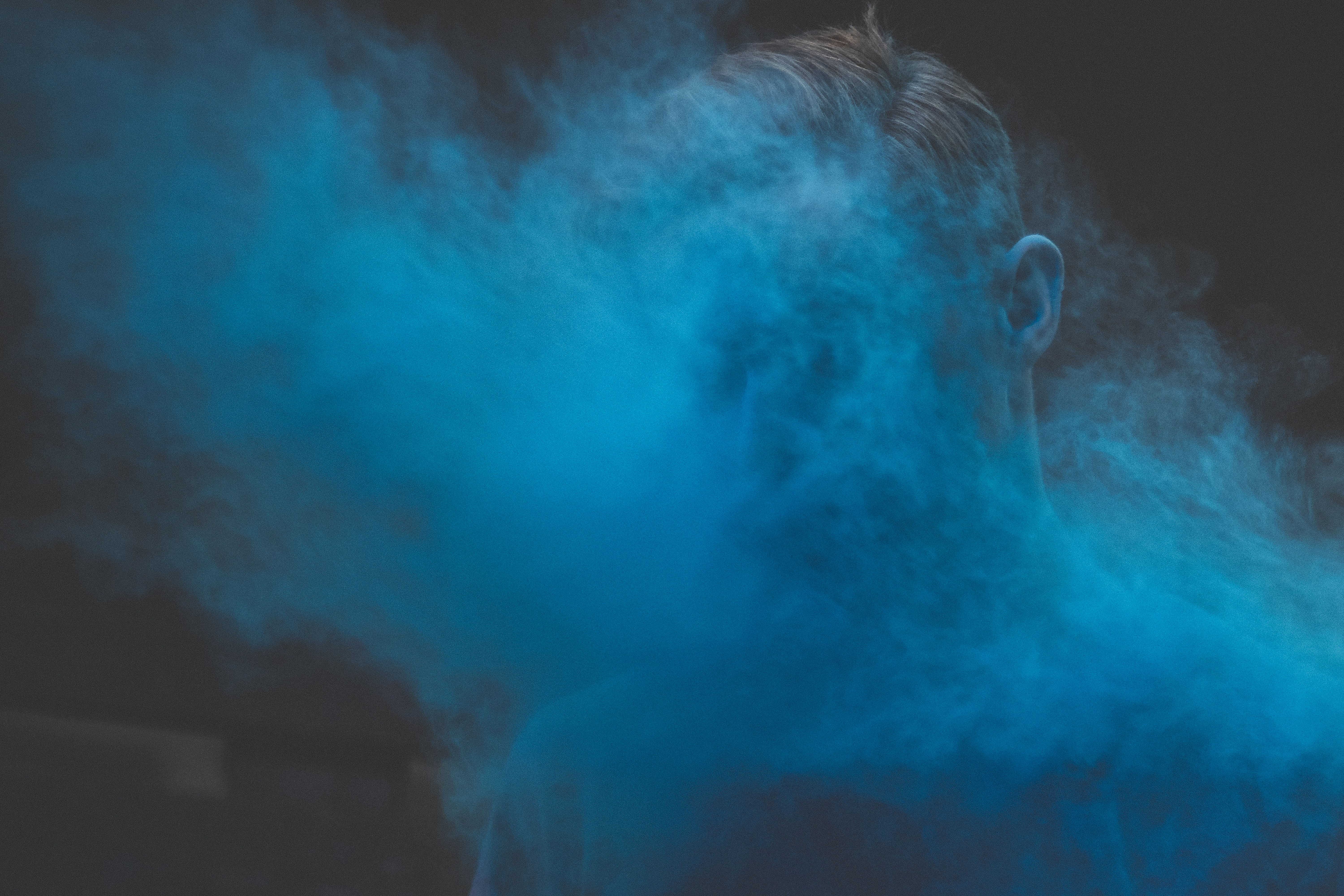 man's face covered with smoke