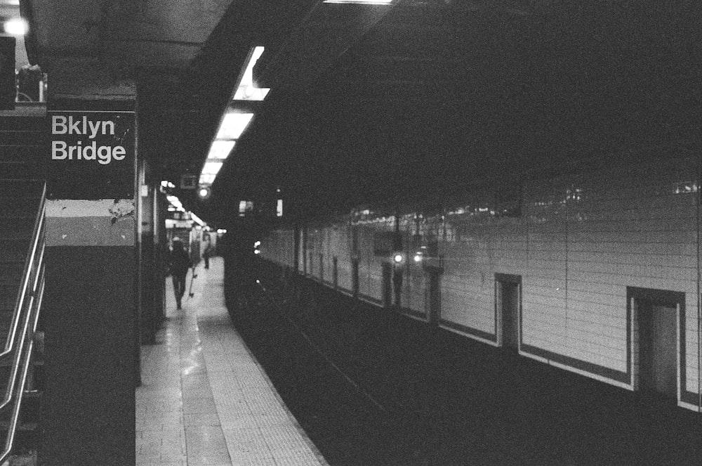 grayscale photography of Brooklyn Bridge subway