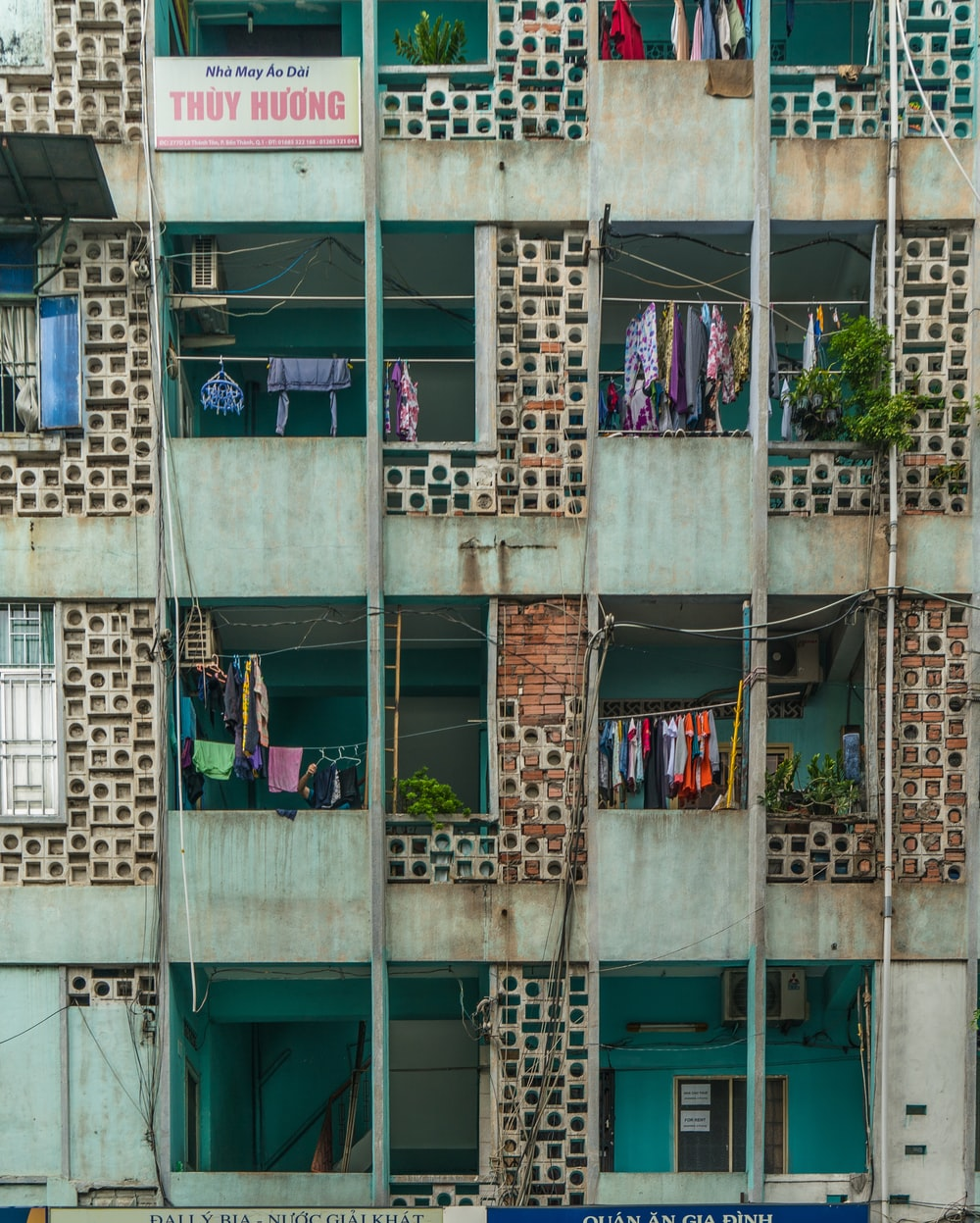 clothes hanged from apartment-style building