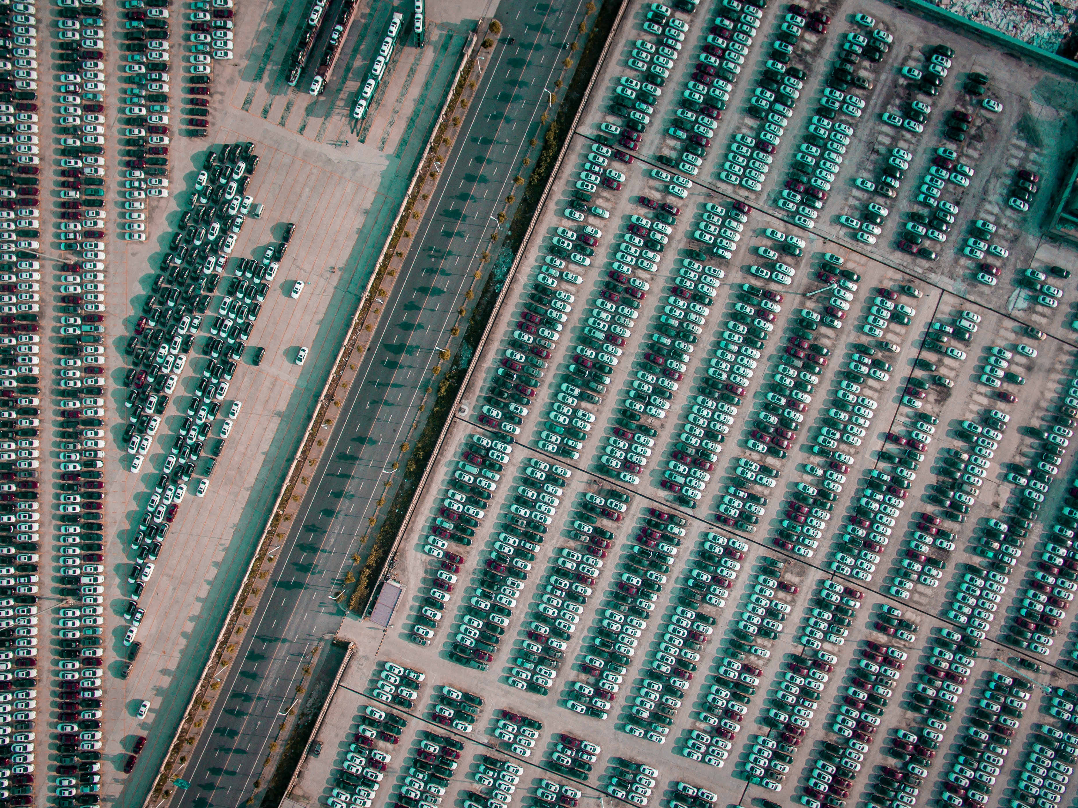 vehicle park on parking lot near gray highway aerial photography