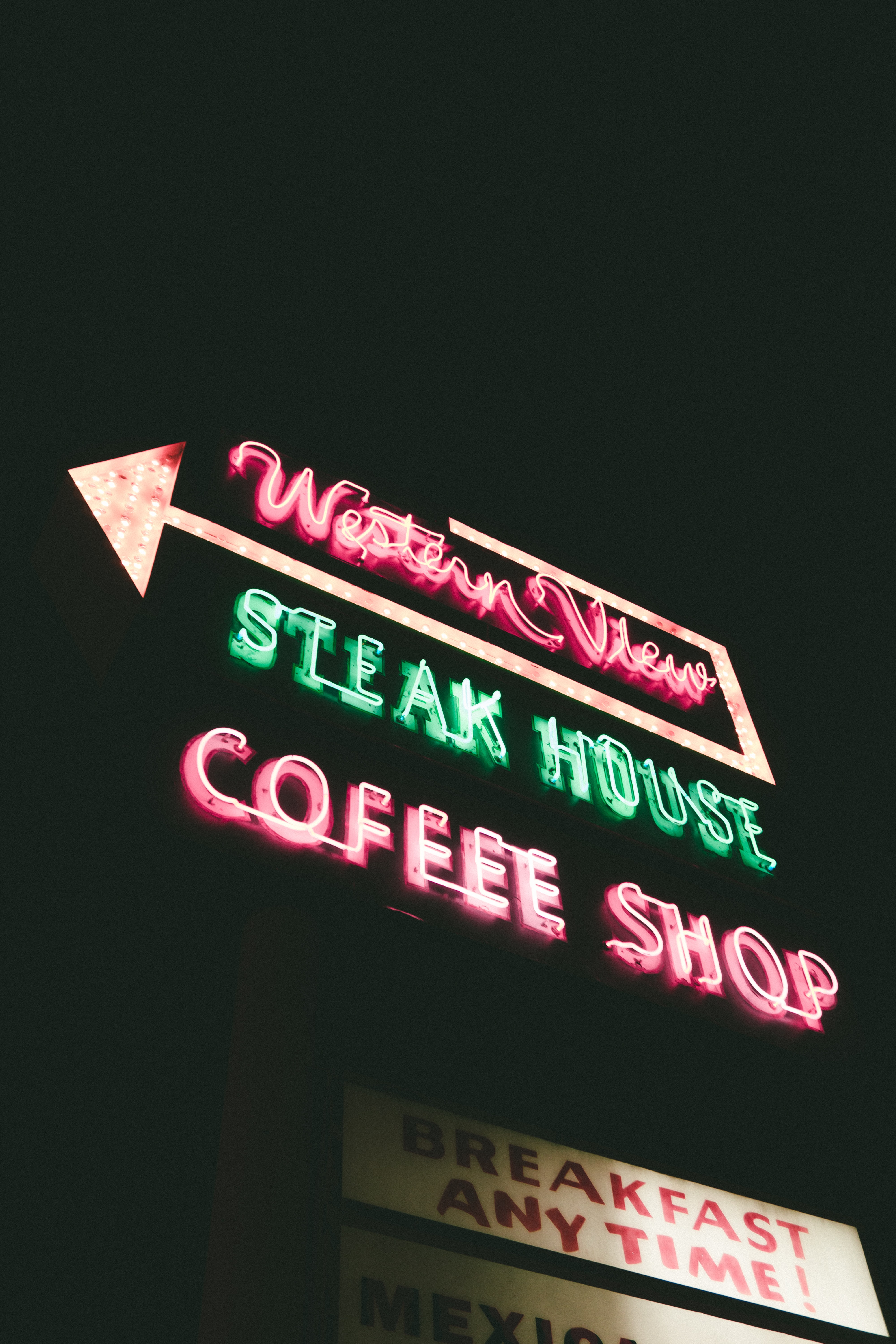 low angle photography of Western View Steak House Coffee shop neon signage turned on at night