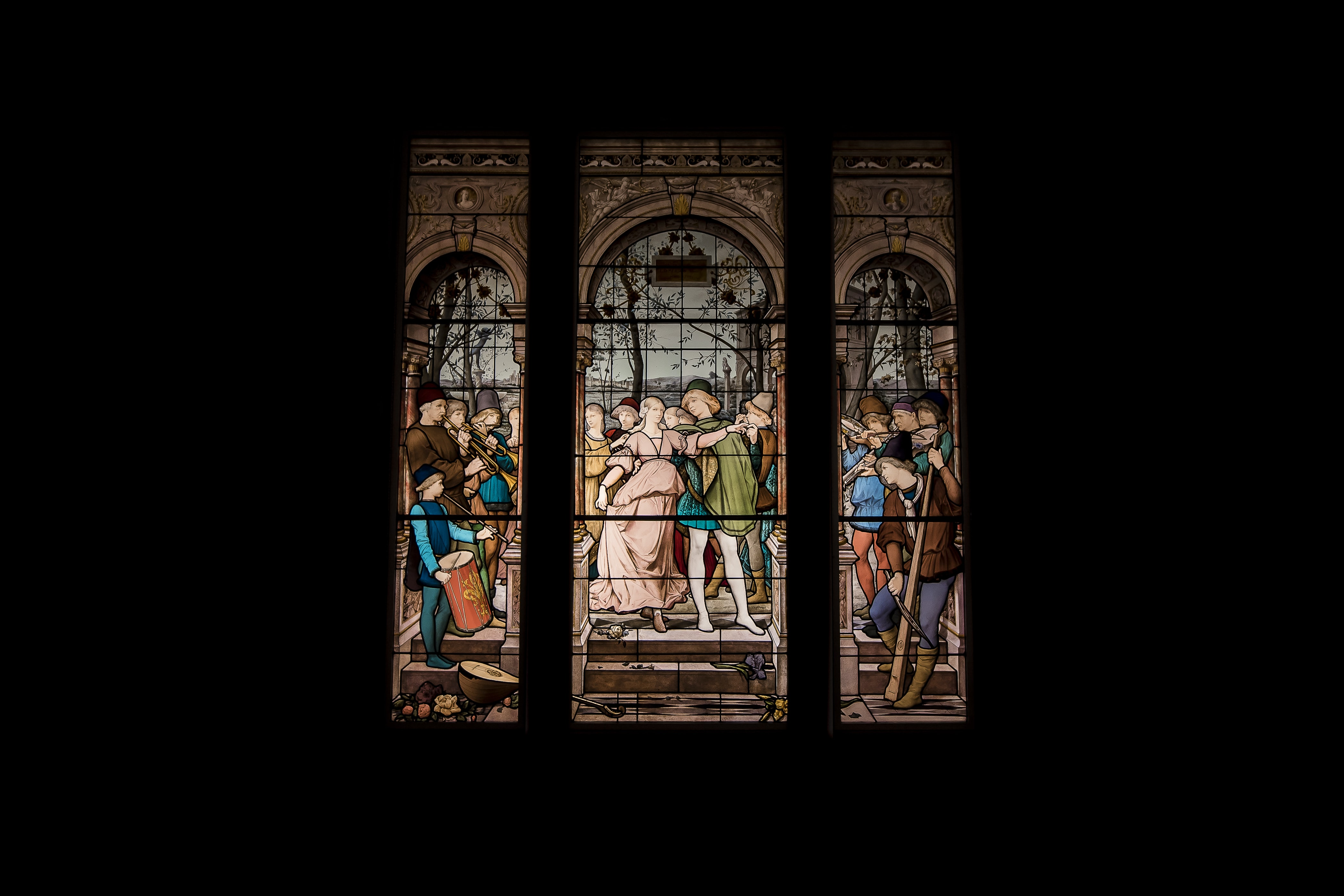 white and multicolored people dancing stain glass