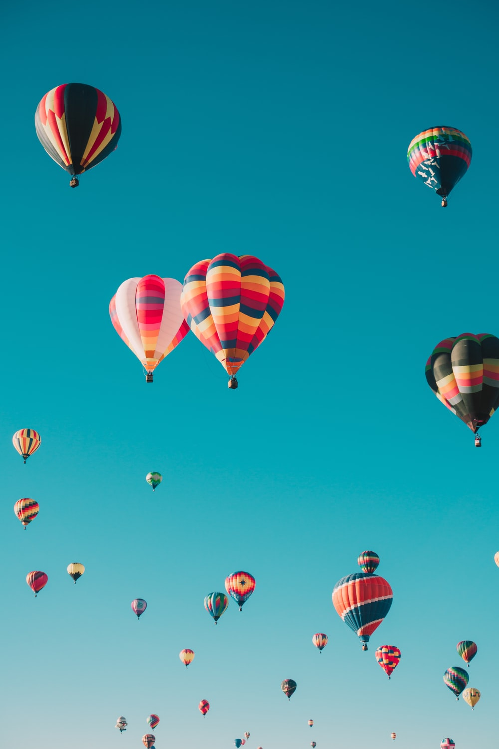 assorted hot air balloons flying at high altitude during daytime