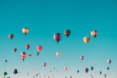 assorted-color hot air balloons during daytime hot air balloon zoom background
