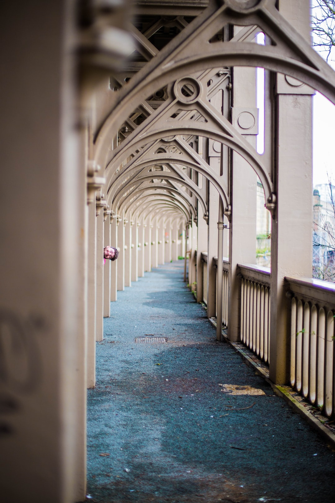 I was walking through this tunnel on the High-Level Bridge in Newcastle when all of a sudden this face popped out from behind one of the pillars.