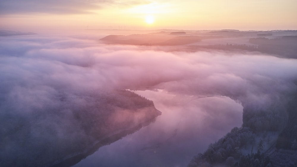 landscape photography of foggy river