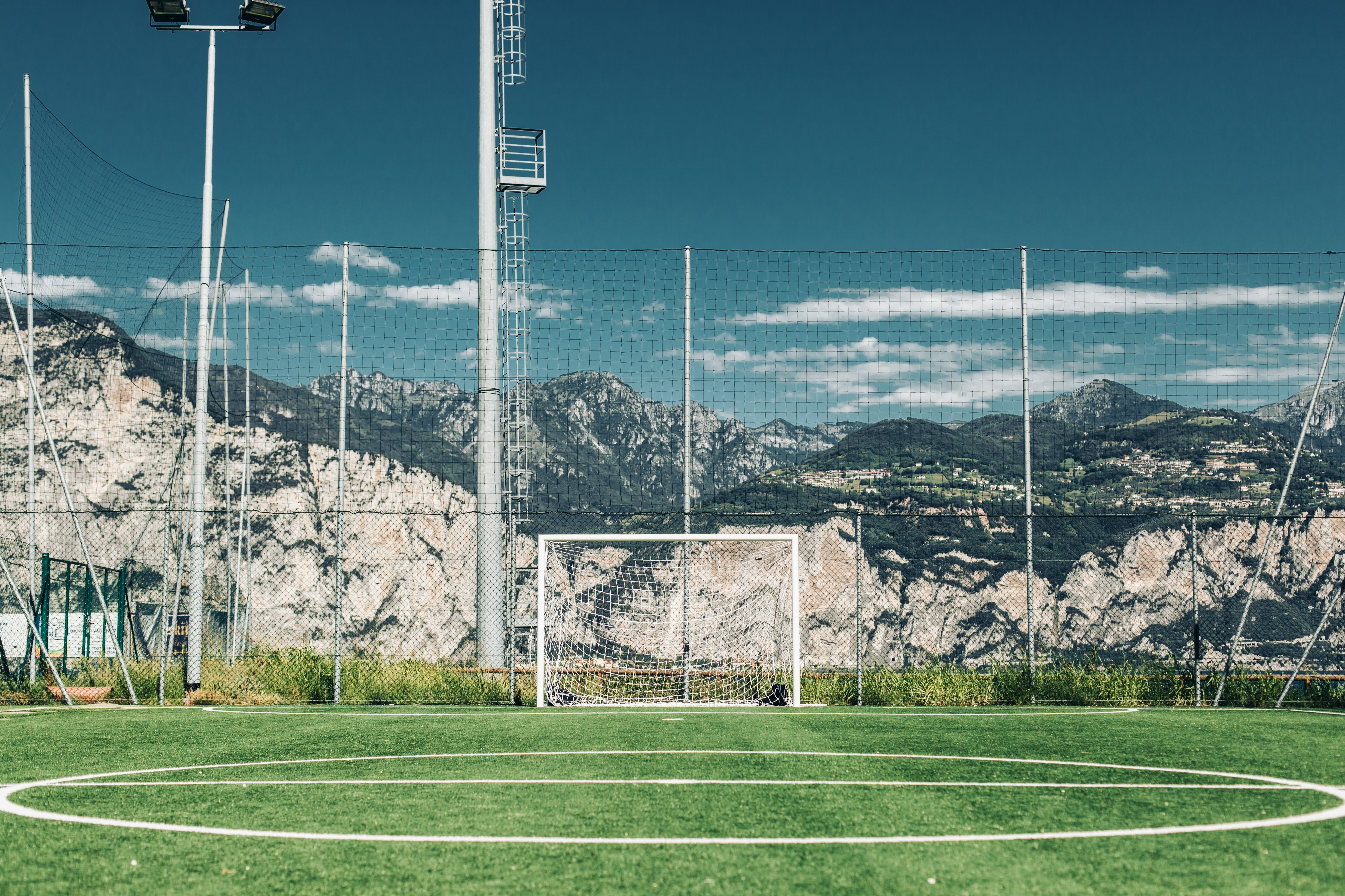 soccer field in distant of mountain