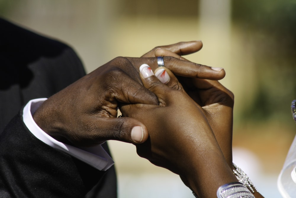 woman fitting ring to man