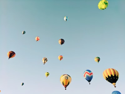 hot air balloons flying in the sky hot cider teams background