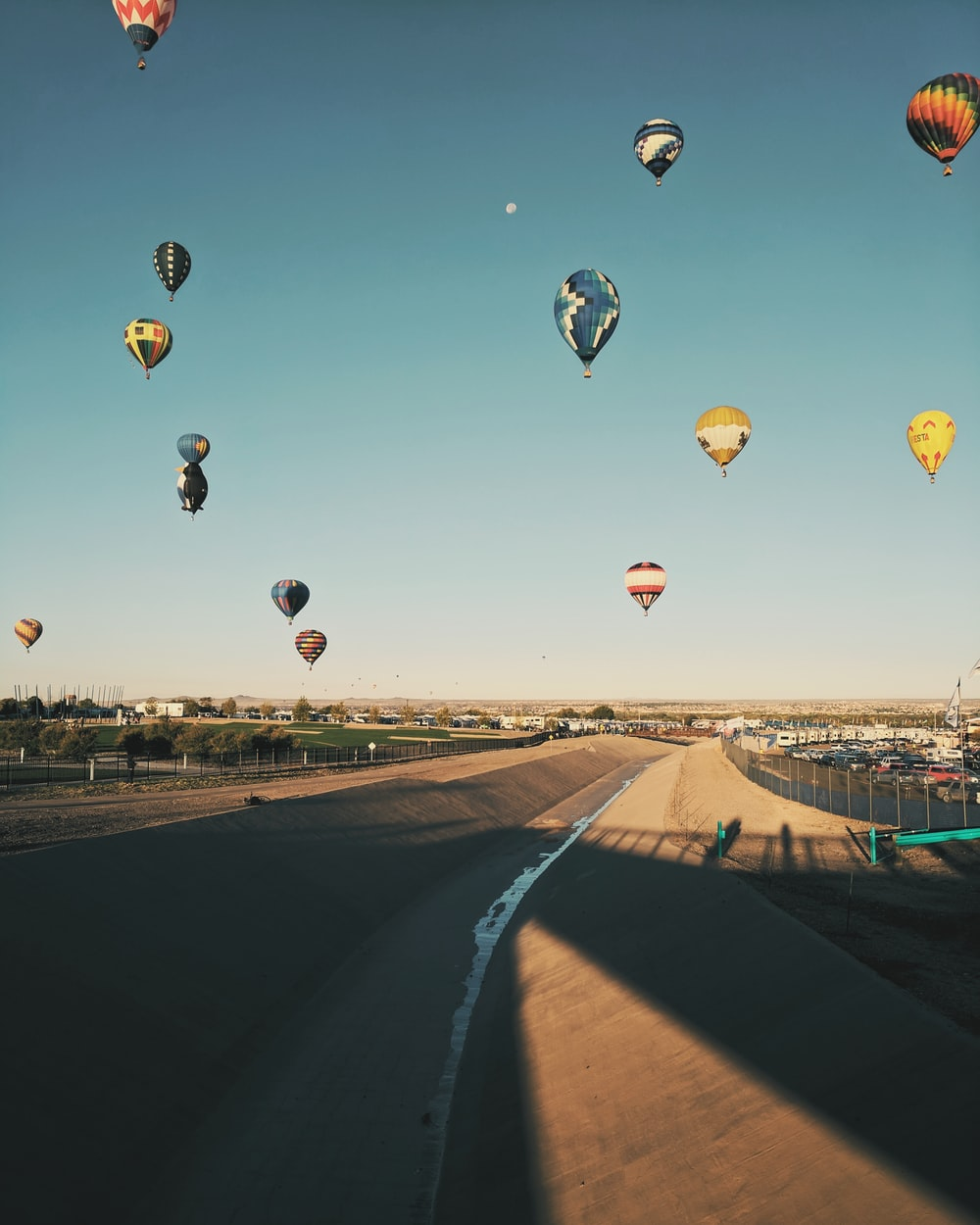 floating hot air balloons under blue calm sky