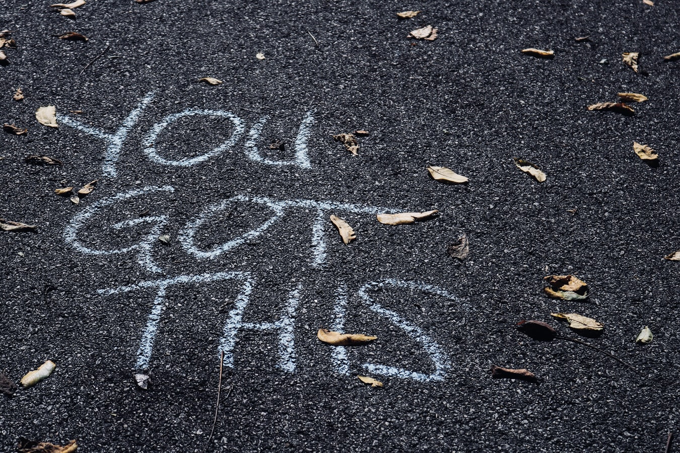 You Got This written in chalk to help cope with job loss