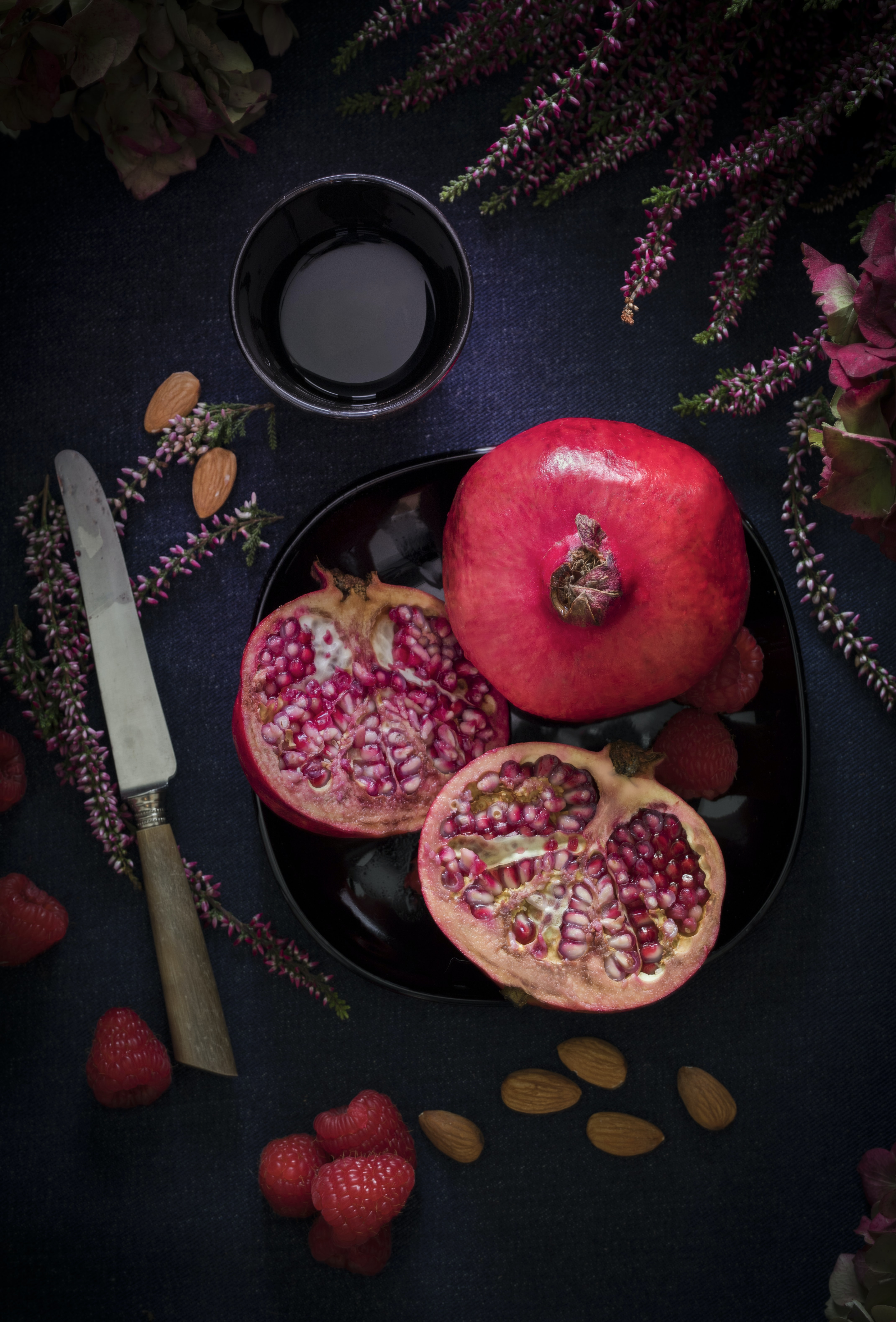 red fruit on black plate