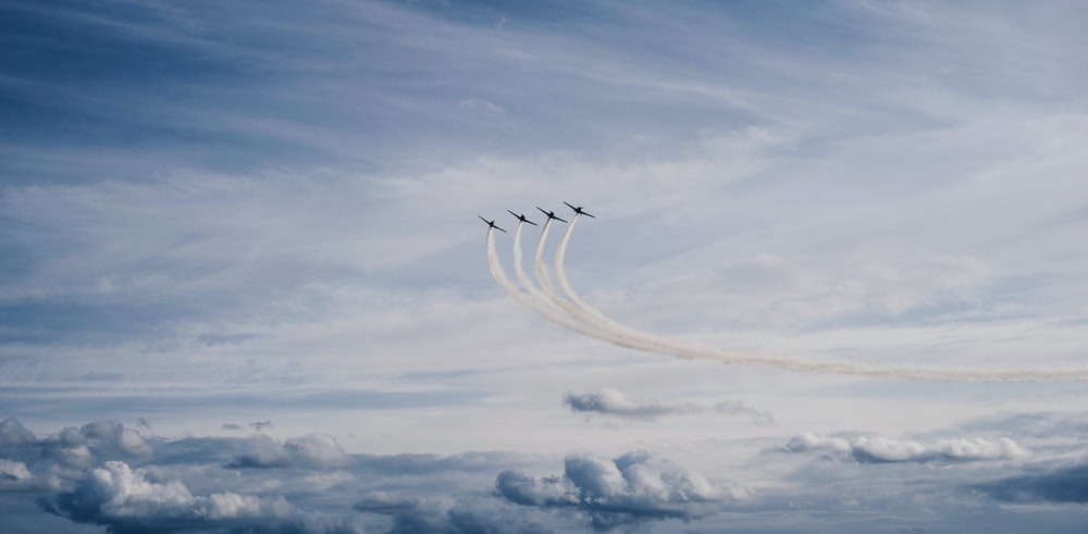 four jet contrails during daytime