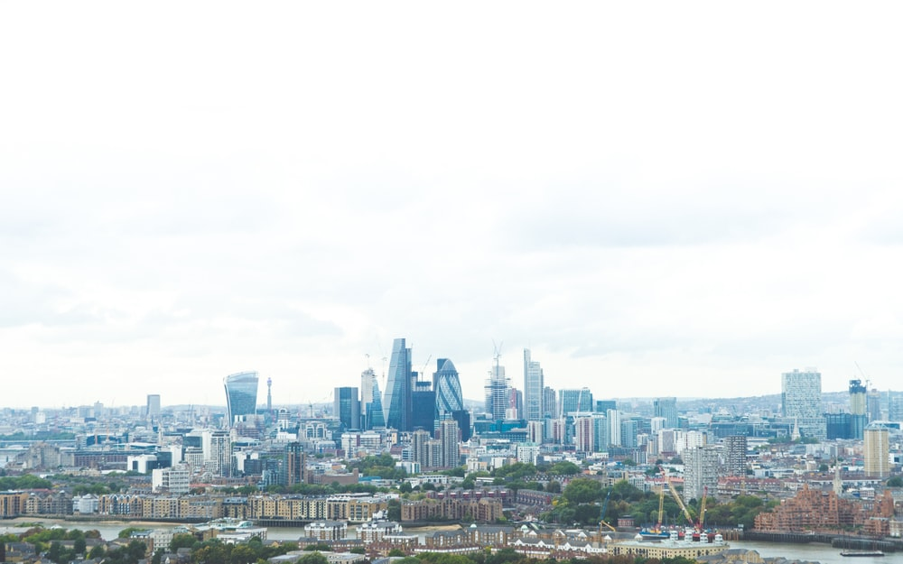 landscape photo of city under cloudy sky during daytime