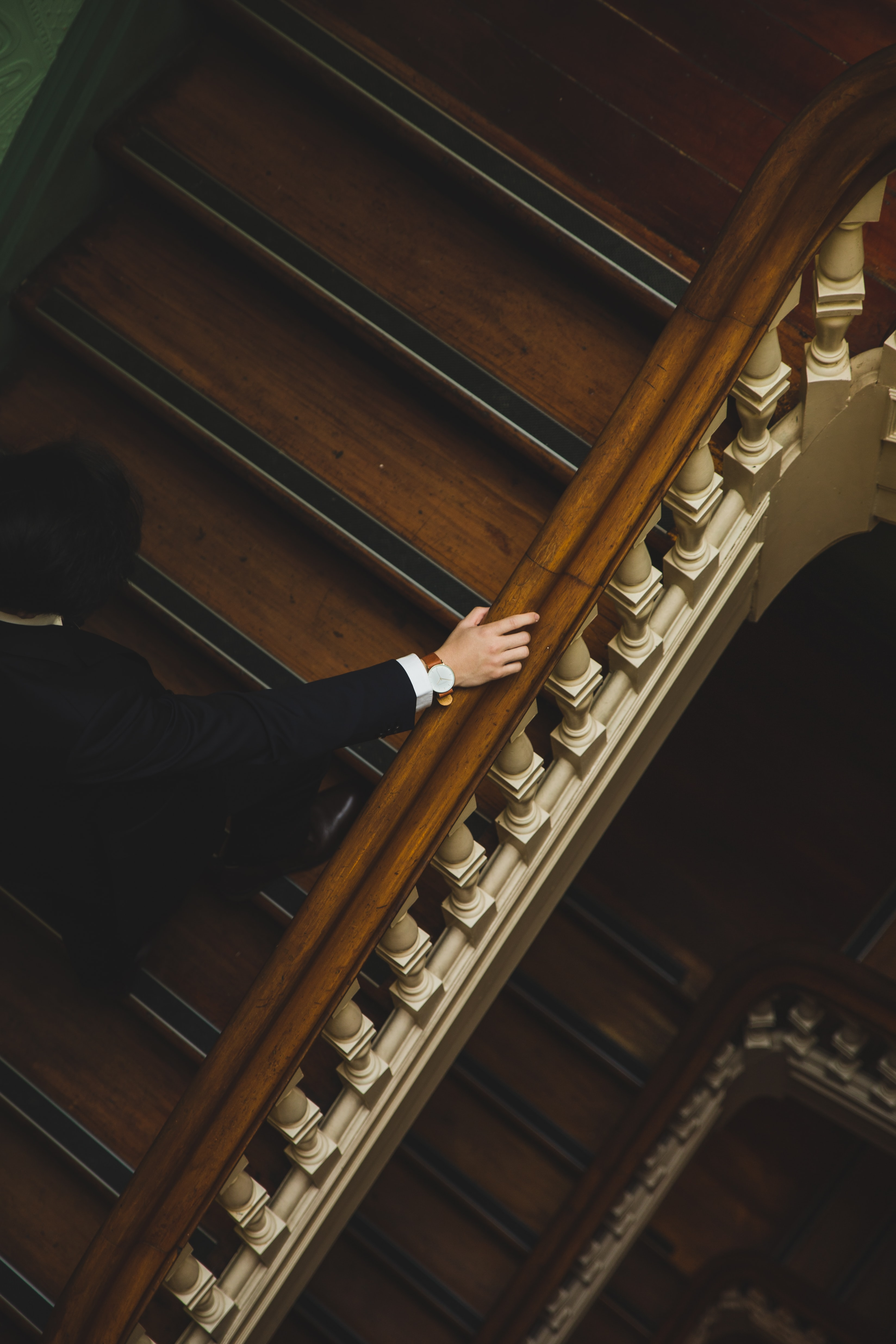 man climbing up the wooden stairs