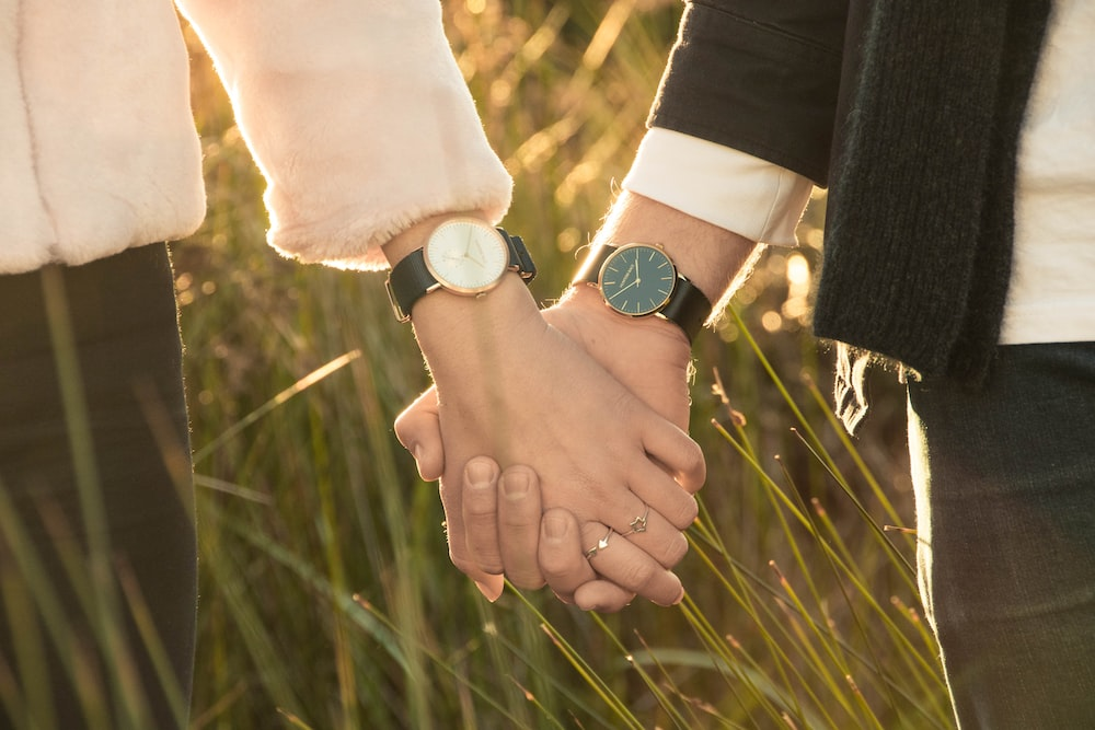 woman and man hand holding