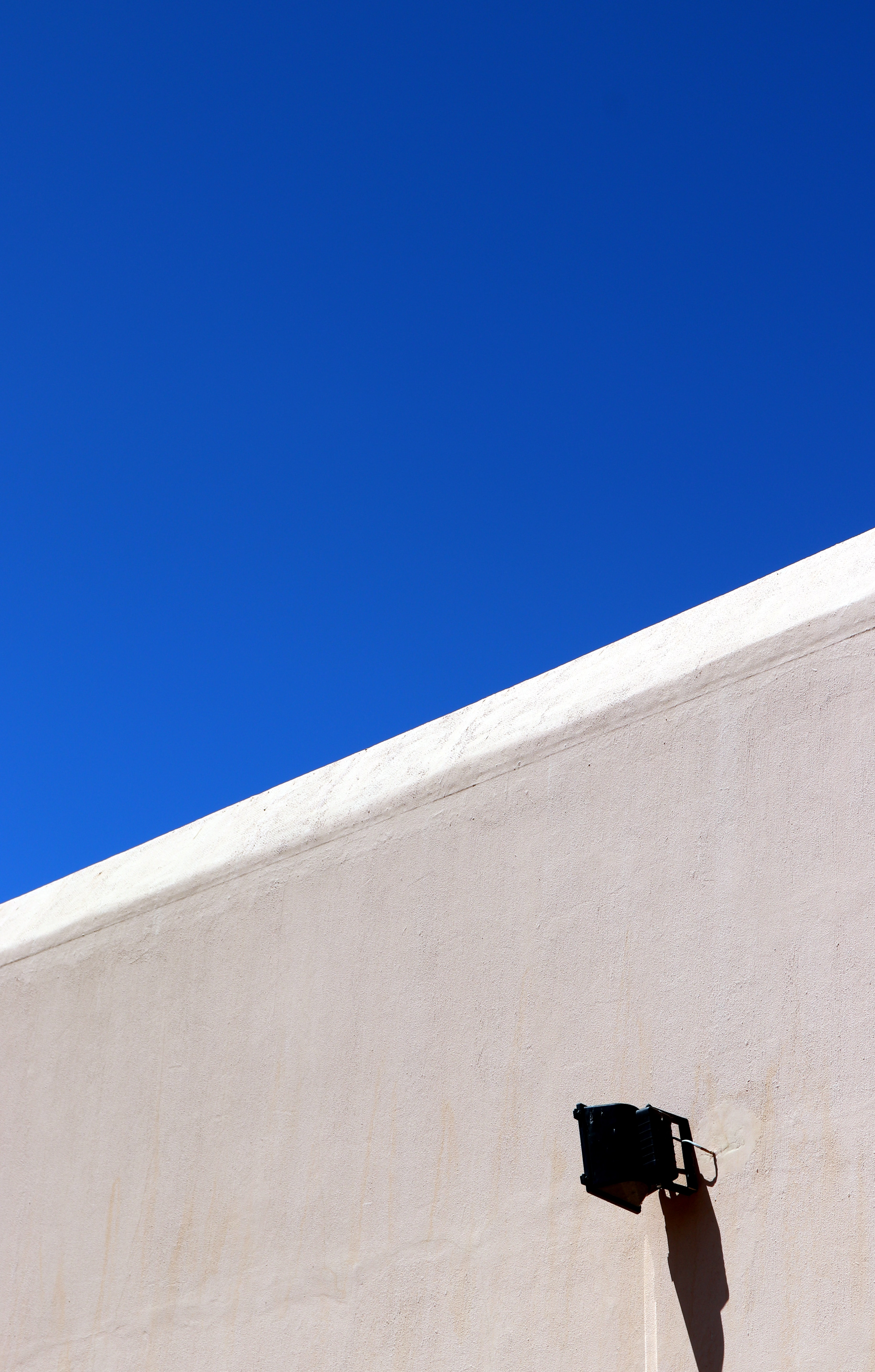 gray concrete wall under blue sky