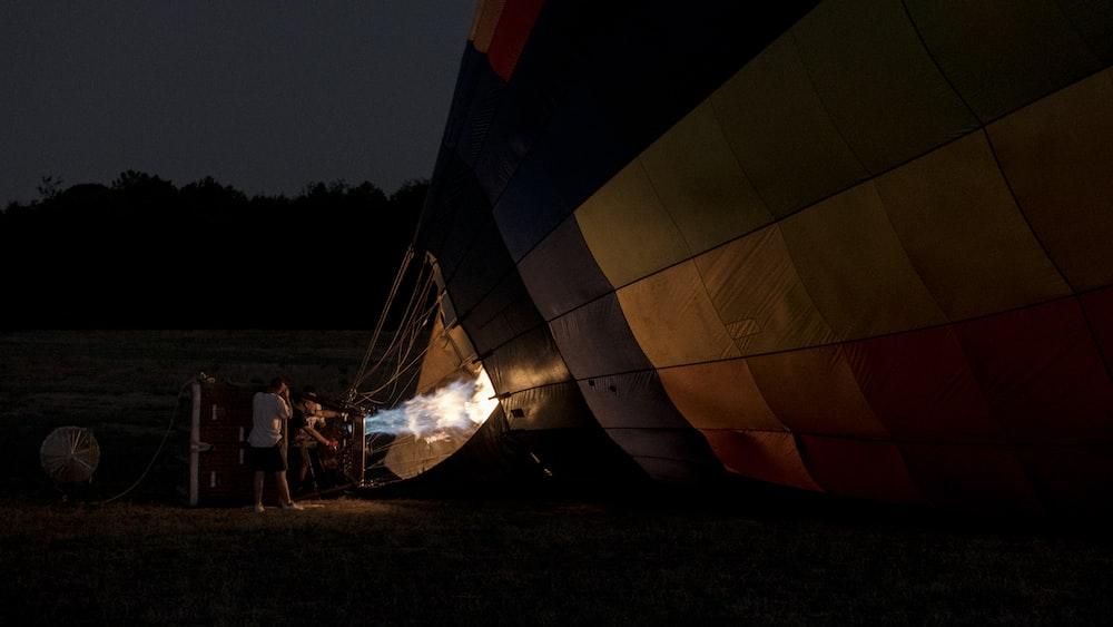 two men starting hot air balloon