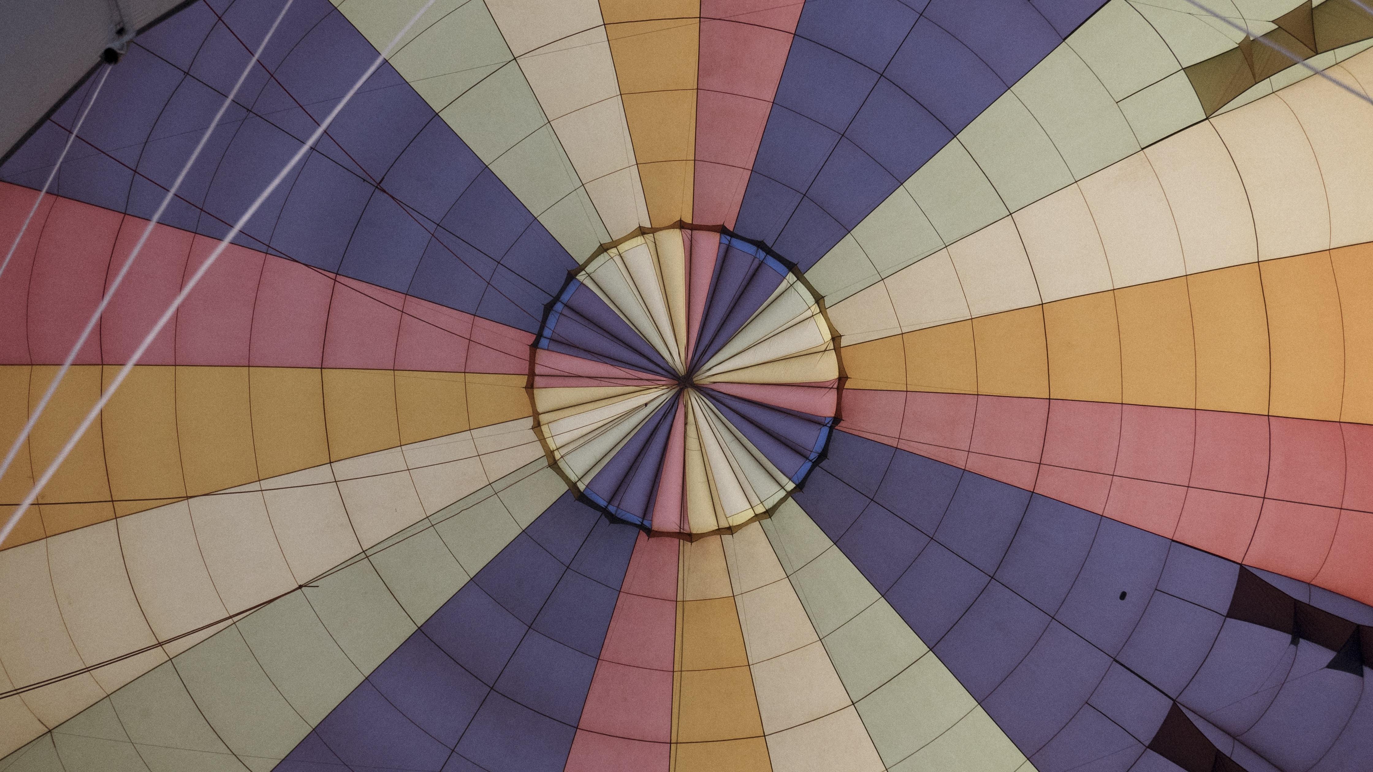 low angle photography of parabolic umbrella