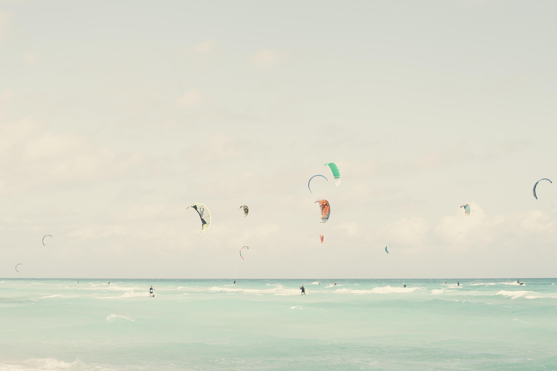 many people parachuting during daytime