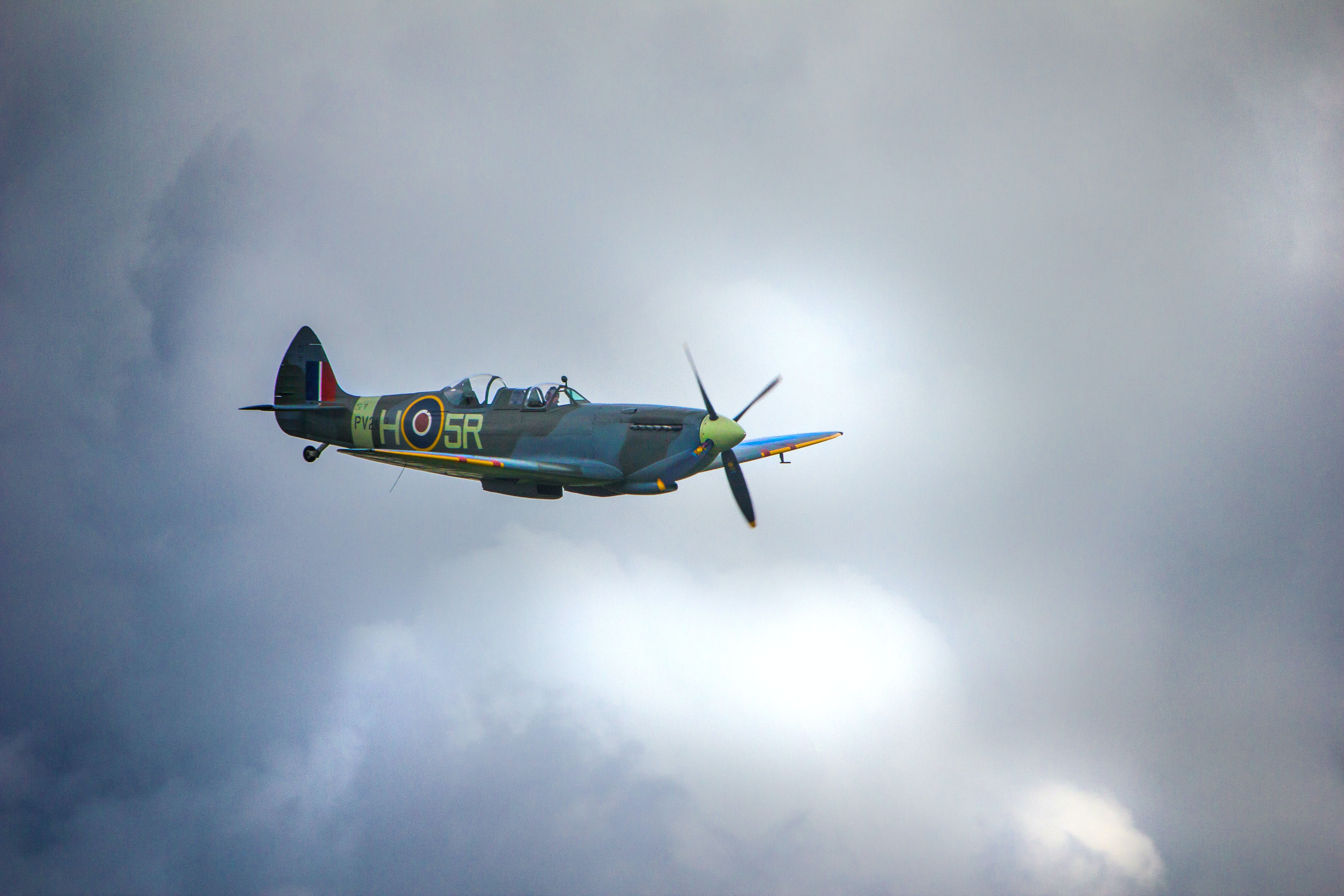 blue and green aircraft flyin in the sky