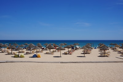 brown parasol on seaside during daytime