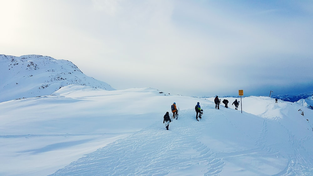people walking on snow mountain