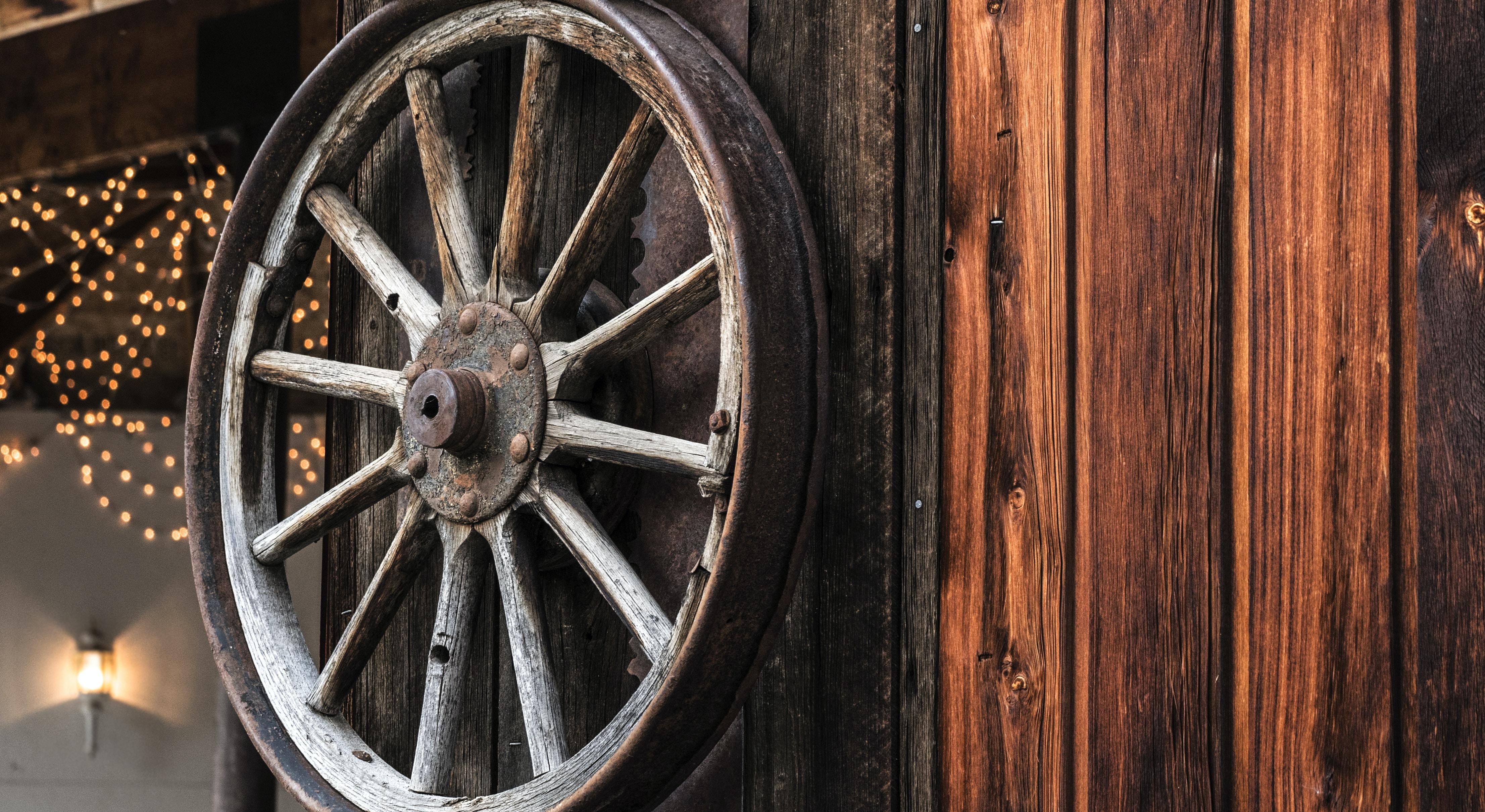 brown carousel wheel hanging on wall