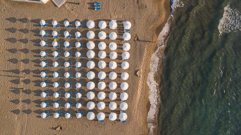 aerial photography of patio umbrellas on beach