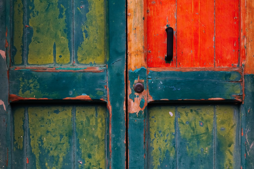 green and red wooden door