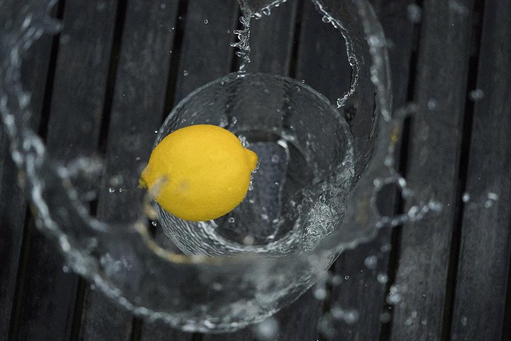yellow lemon on drinking glass