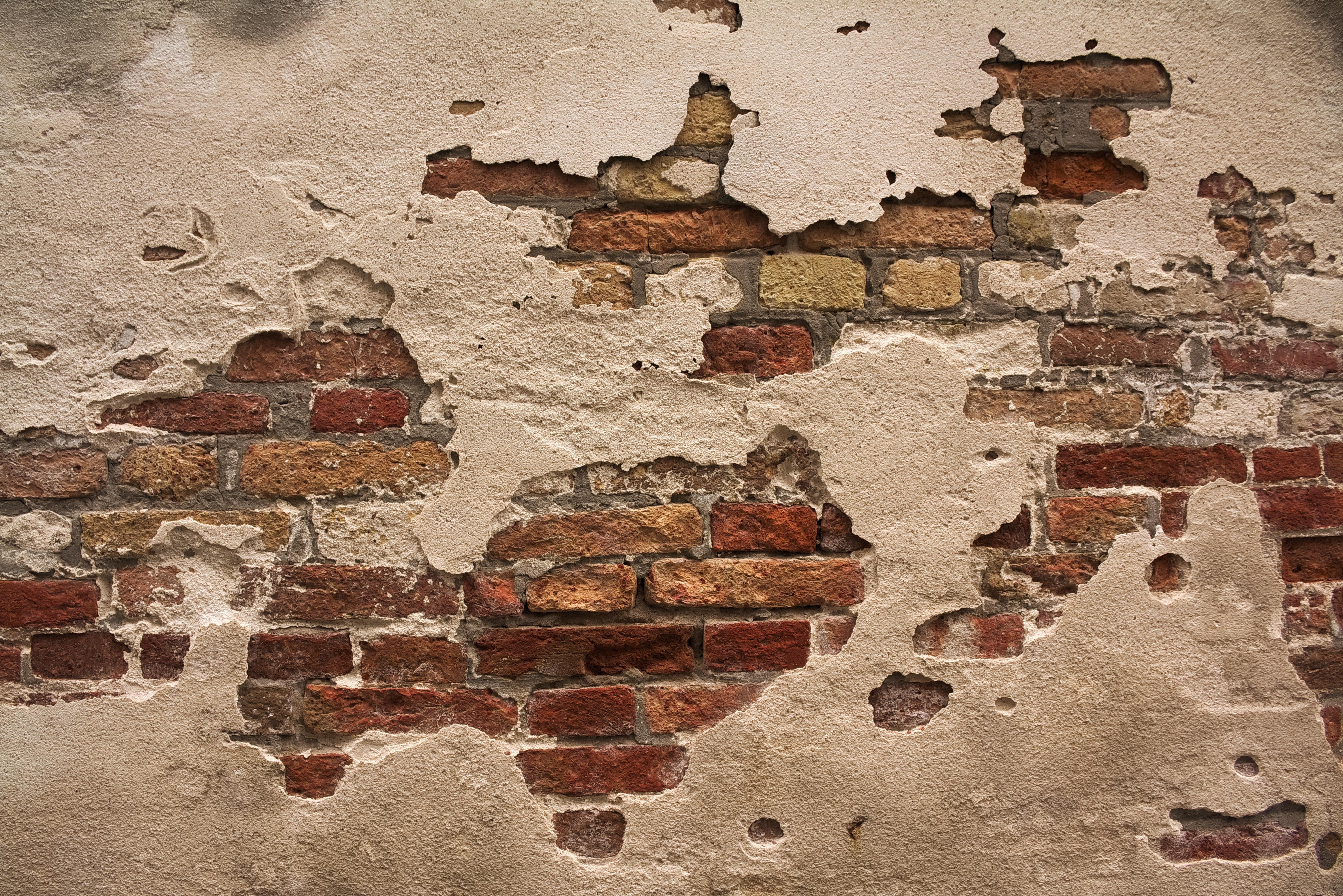 brown brick wall closeup photography