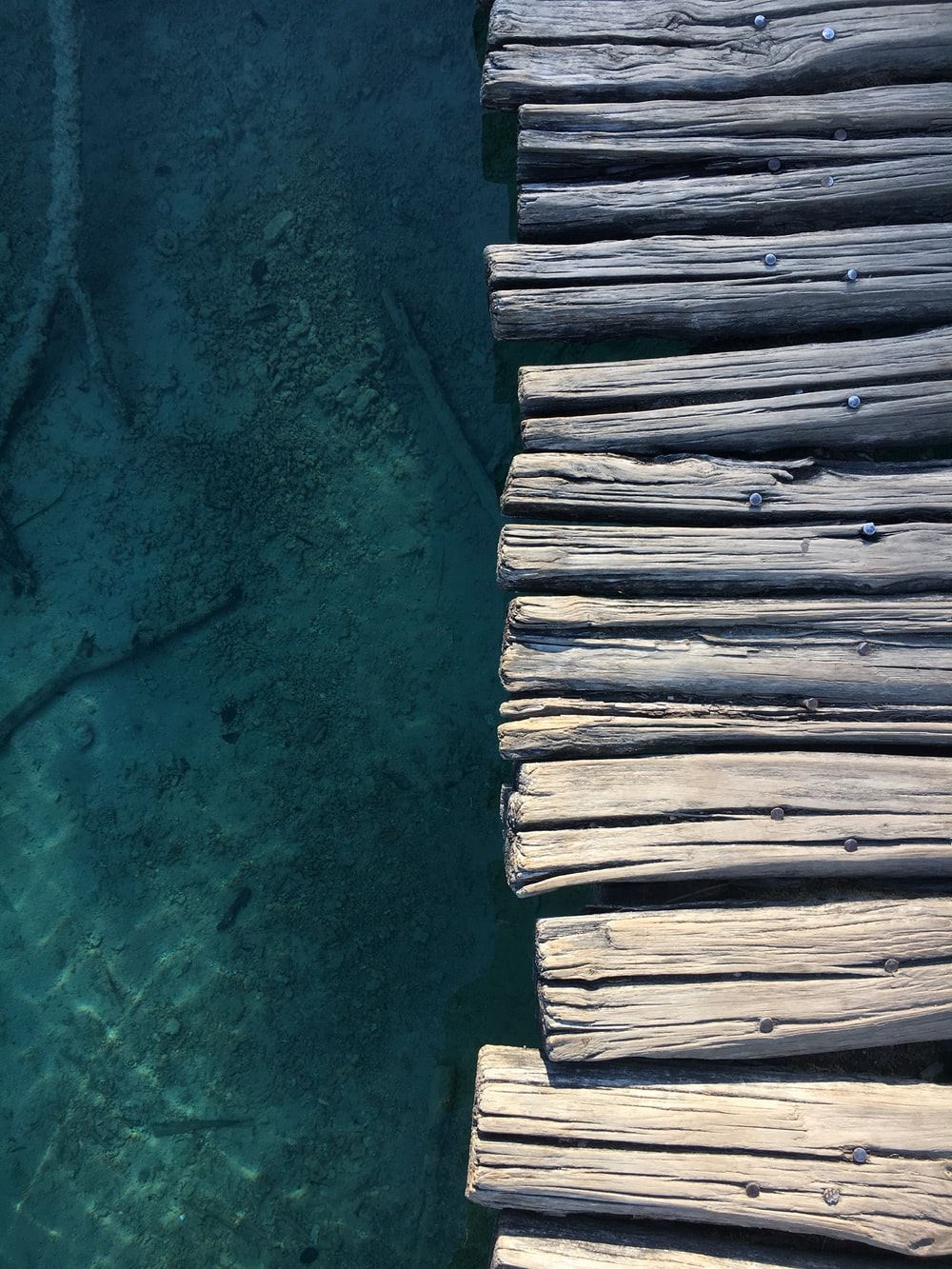 aerial photography of gray wooden seadock