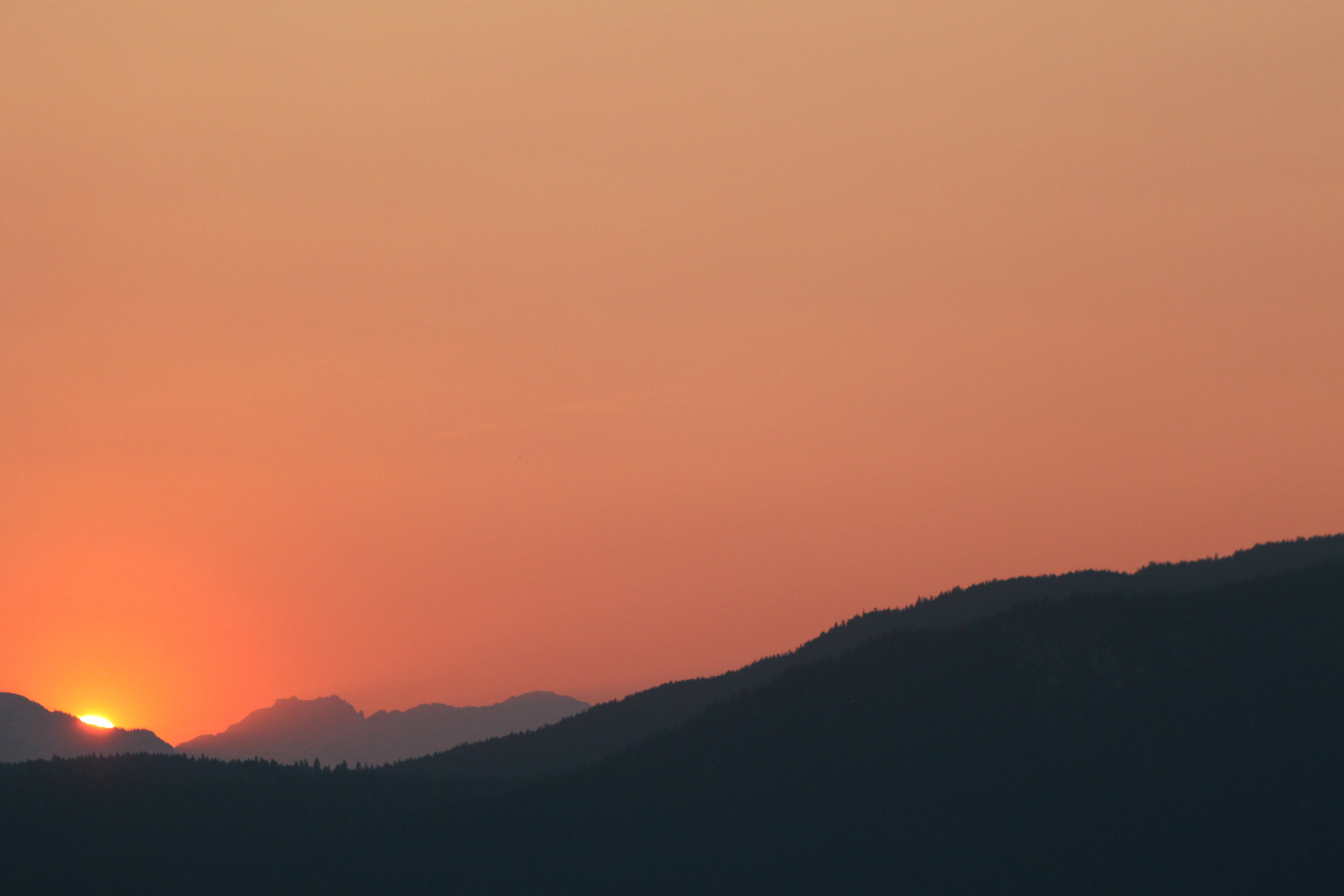 silhouette photo of mountain at sunset