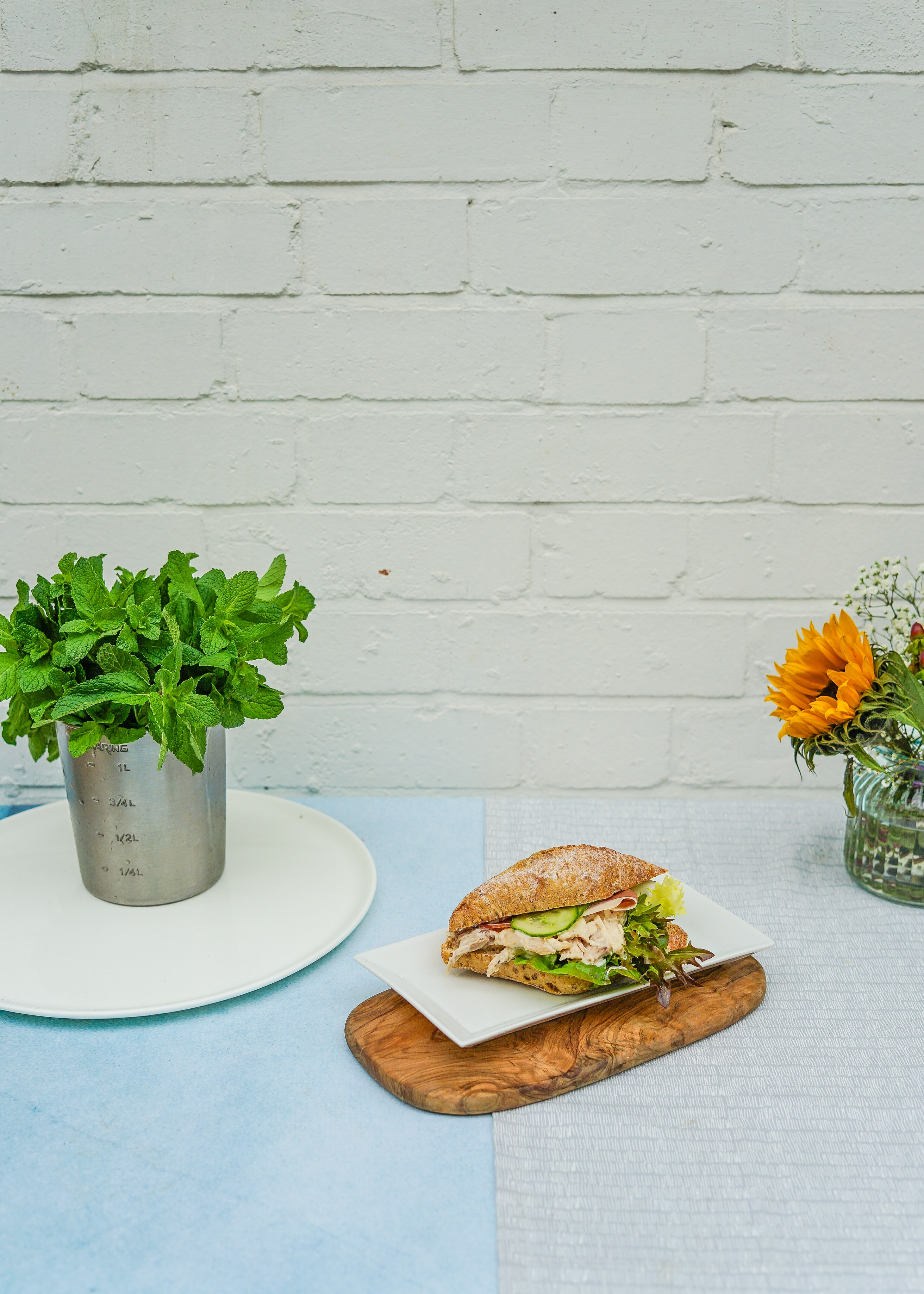 clubhouse sandwich on white ceramic plate