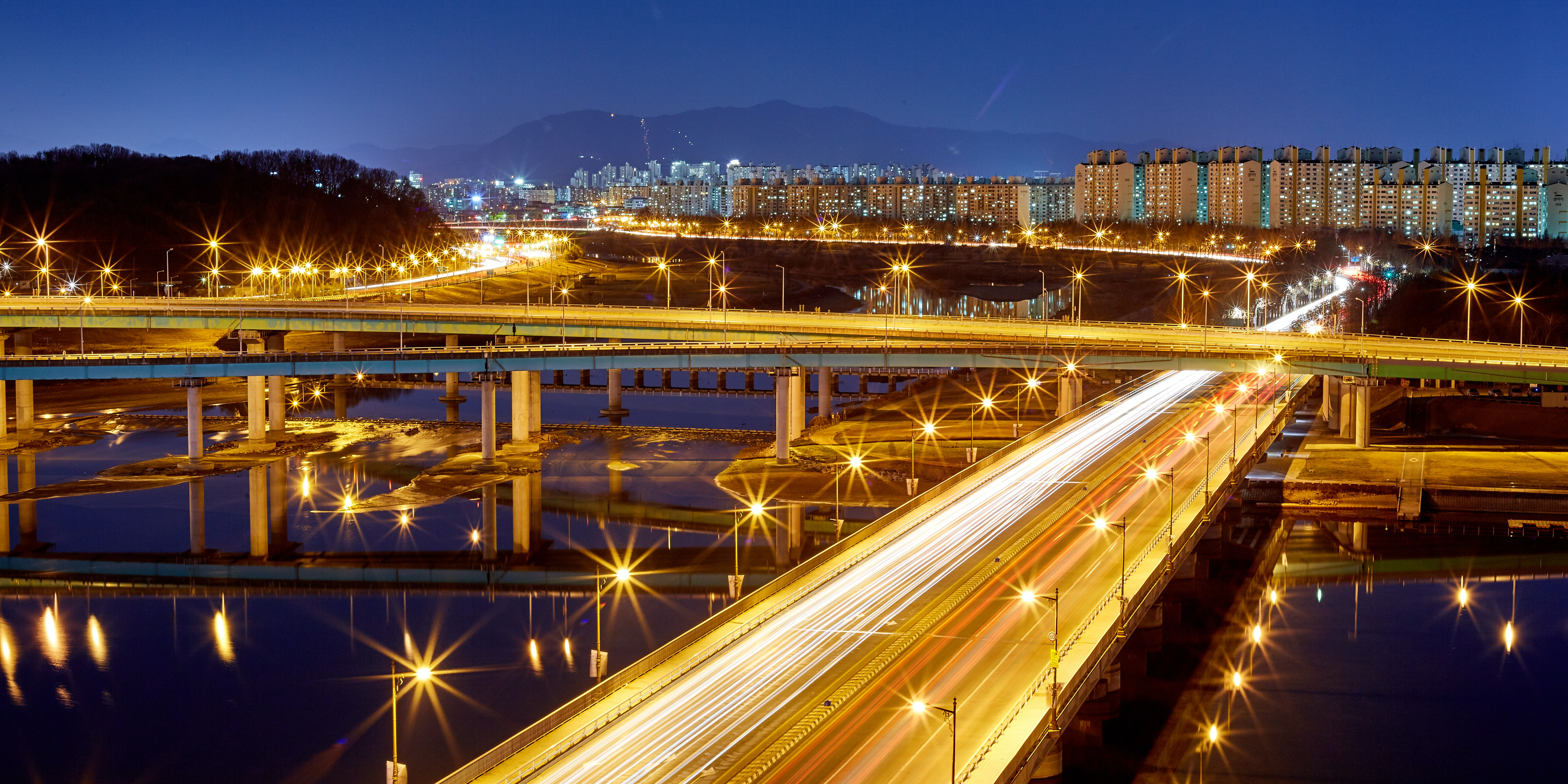 timelapse photography of cars running on highway and flyover at night