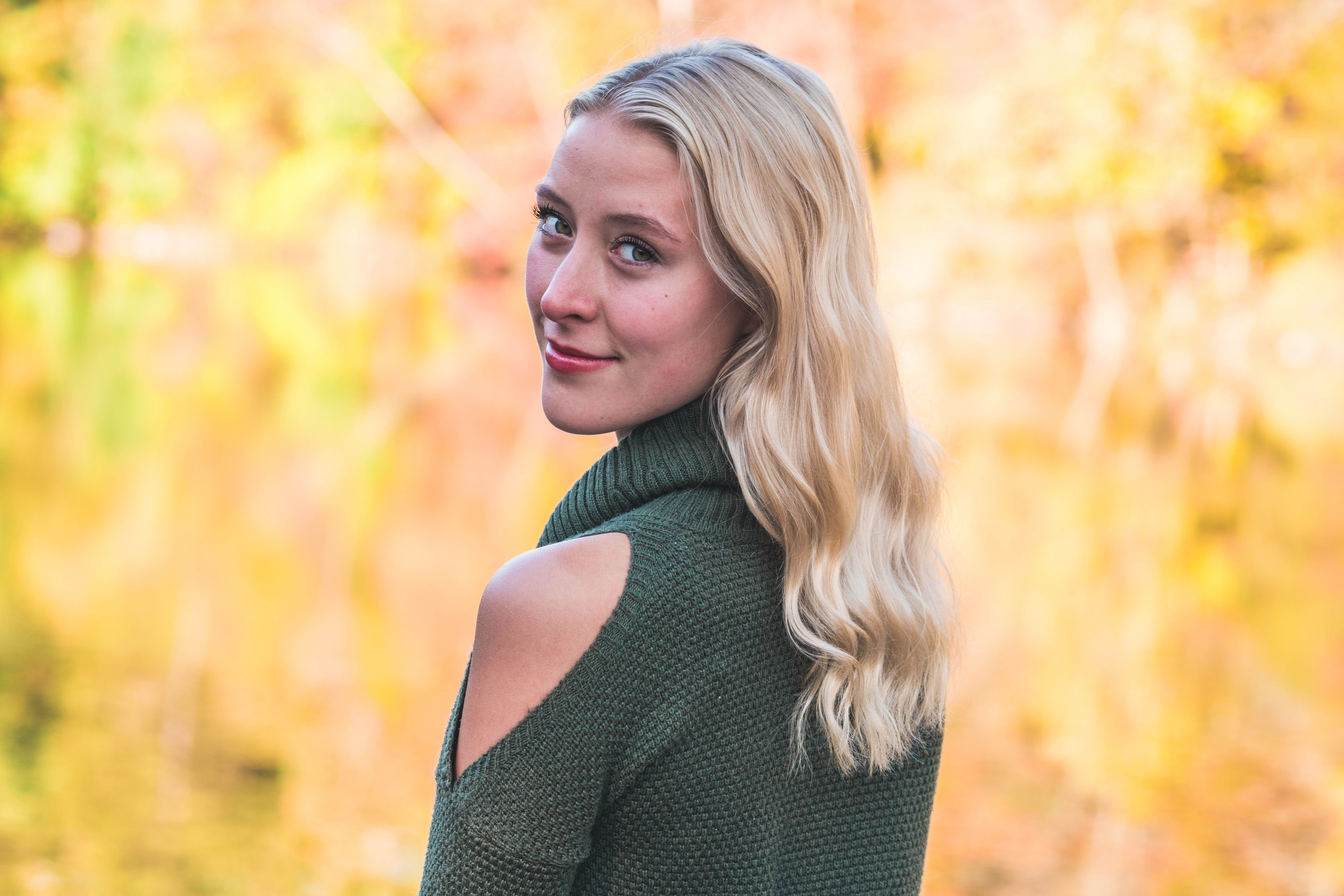 blonde-haired woman smiling while taking photo